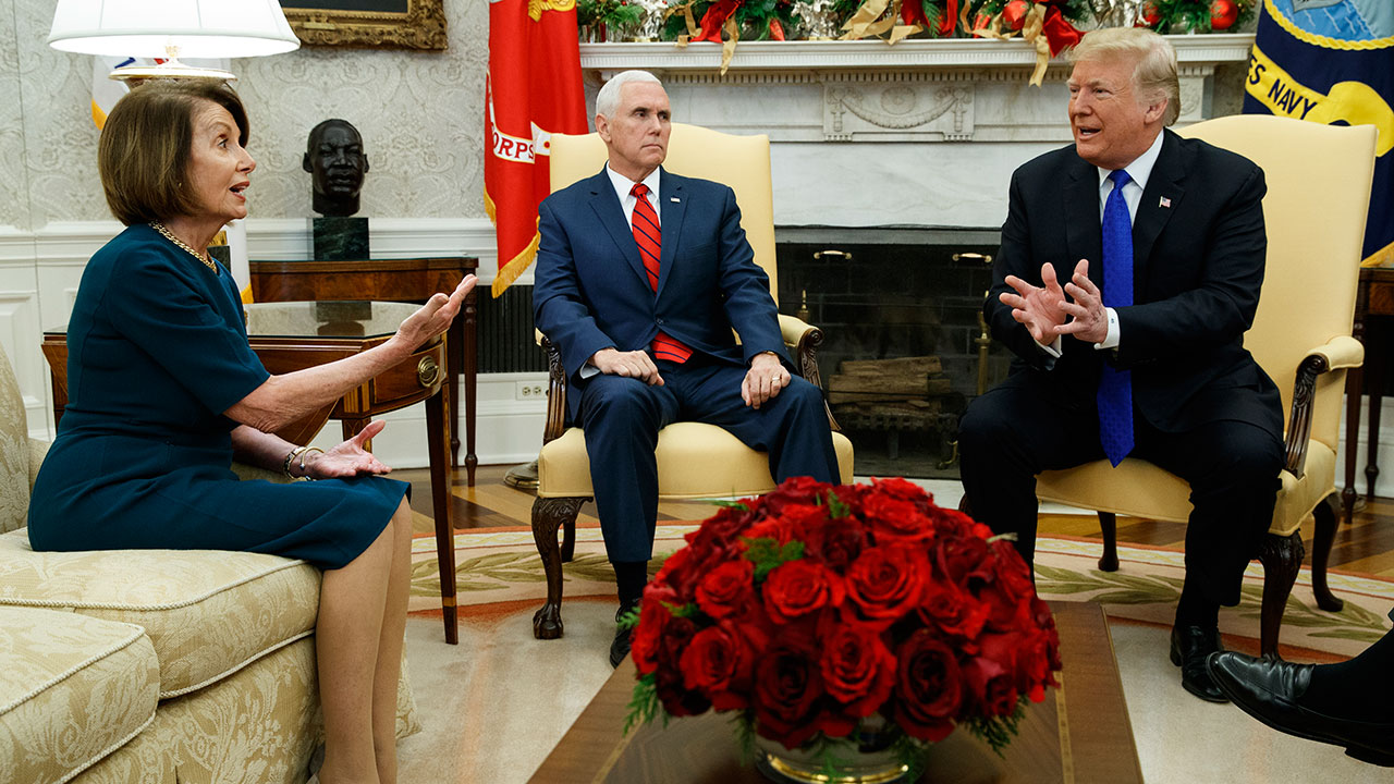 Vice President Mike Pence, center, looks on as House Minority Leader Rep. Nancy Pelosi, D-Calif., and President Donald Trump speak during a meeting Dec. 11, 2018, in Washington