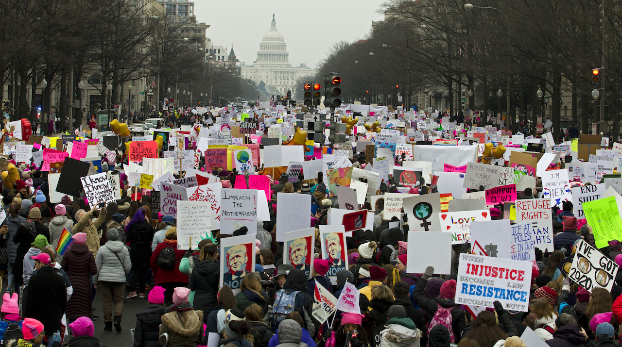 Demonstrators march on Pennsylvania Ave. during the Womens March in Washington on Saturday, Jan. 19, 2019.