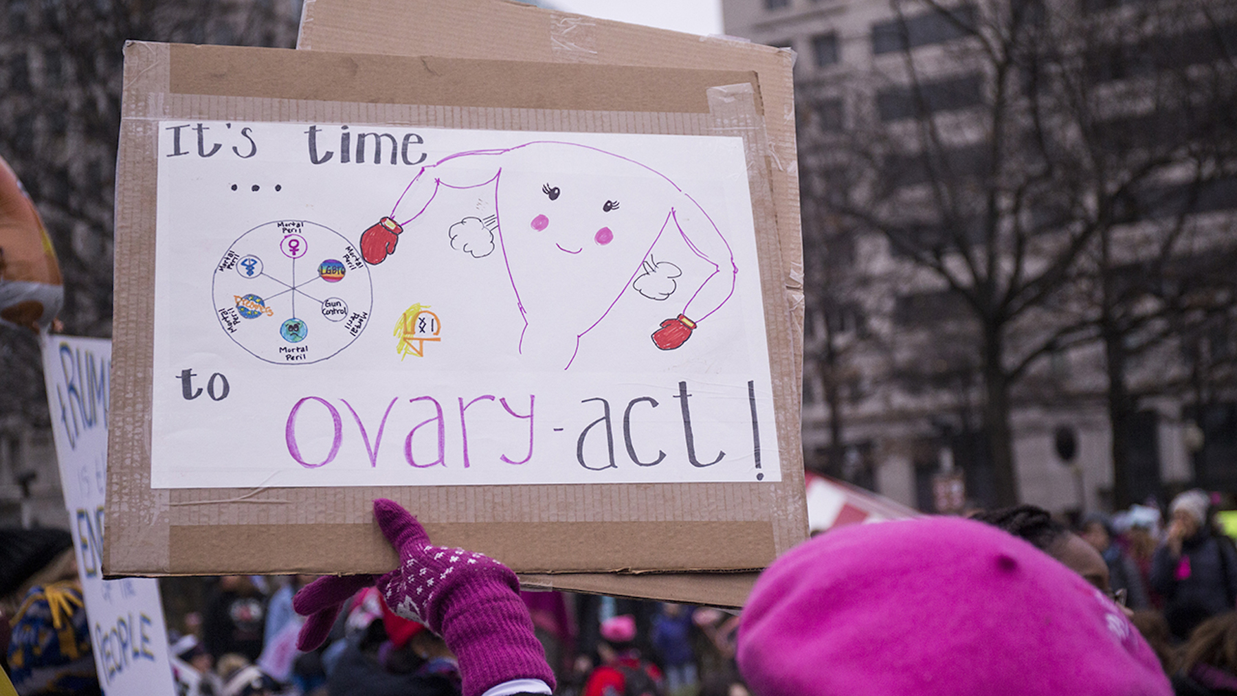 A demonstrator holds a sign during the 2019 Womens March on January 19, 2019, in Washington, DC.
