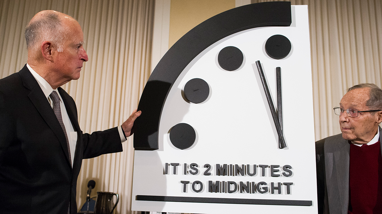 Former California Gov. Jerry Brown, left, and former Secretary of Defense William Perry unveil the Doomsday Clock during a news conference in Washington Jan. 24, 2019.
