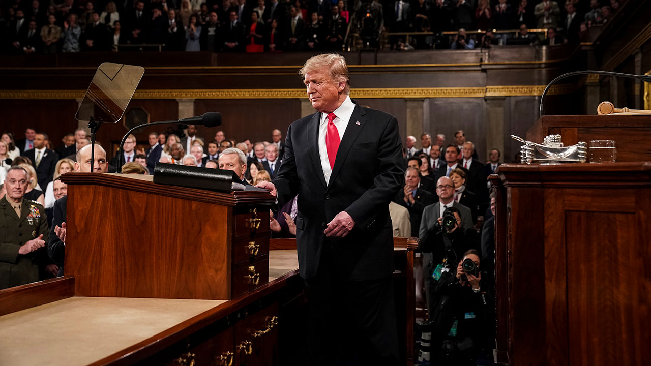 President Donald Trump arrives in the House chamber before giving his State of the Union address to a joint session of Congress, Tuesday, Feb. 5, 2019, at the Capitol.
