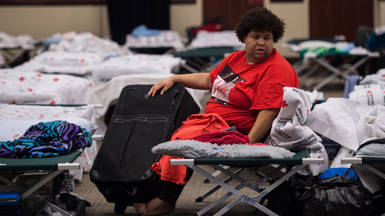 A woman waits inside an American Red Cross evacuation shelter in Chapel Hill, North Carolina on September 17, 2018.