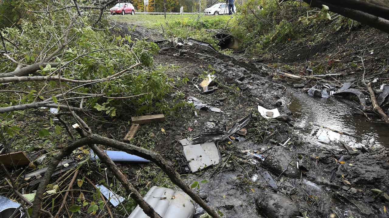 Debris scatters an area Sunday, Oct. 7, 2018, at the site of yesterdays fatal crash Schoharie, N.Y.