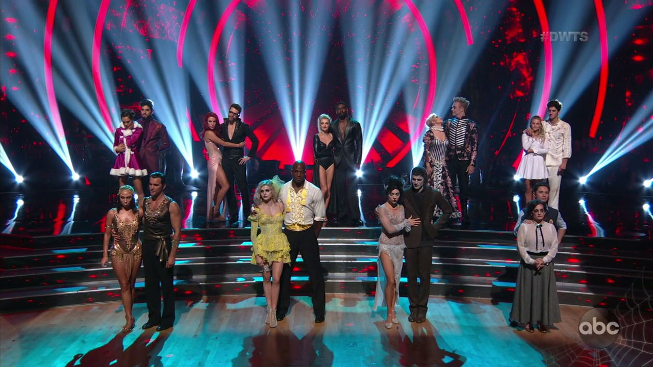 The remaining celebrities and their professional dancing partners stand on stage as they wait to her who is in jeopardy on this week of Dancing with the Stars.