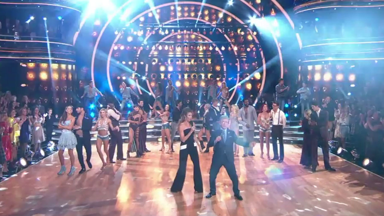 The remaining celebrities and their professional dancing partners stand on stage as they wait to perform on Country Night on this week of Dancing with the Stars.