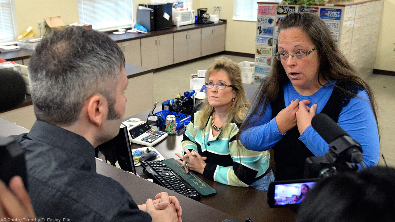 In this Sept. 1, 2015, file photo, Rowan County Clerk Kim Davis talks with David Moore following her offices refusal to issue marriage licenses at the Rowan County Courthouse.