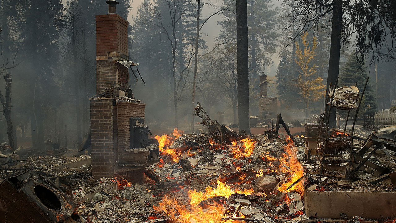 A chimney remains at the site of a home that burned as the Camp Fire moves through the area on November 8, 2018 in Paradise, California
