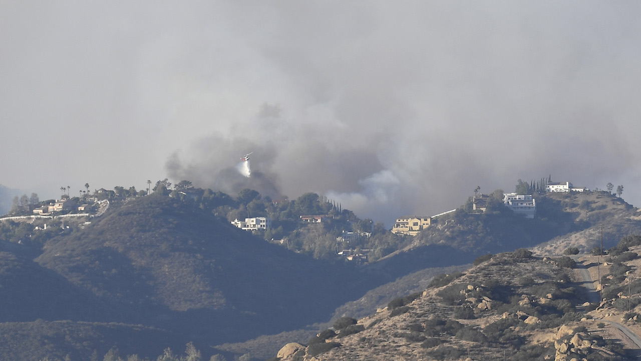 The Woolsey Fire is seen looking towards the Oak Park area on November 9, 2018, in Porter Ranch, California.