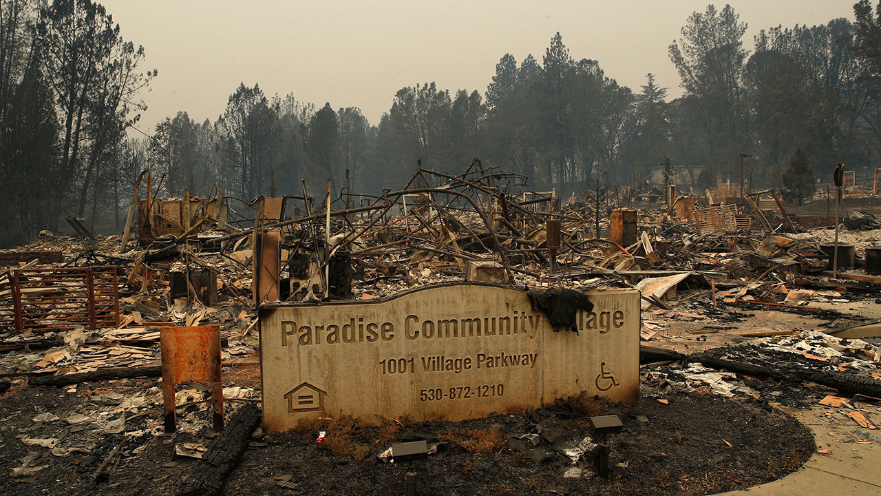 A sign stands at a community destroyed by the Camp fire, Tuesday, Nov. 13, 2018, in Paradise, Calif.