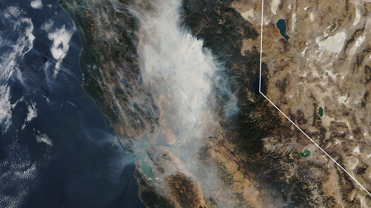 Satellite imagery from NASA shows a cloud of smoke from the Camp Fire over Northern California on Nov. 14, 2018.