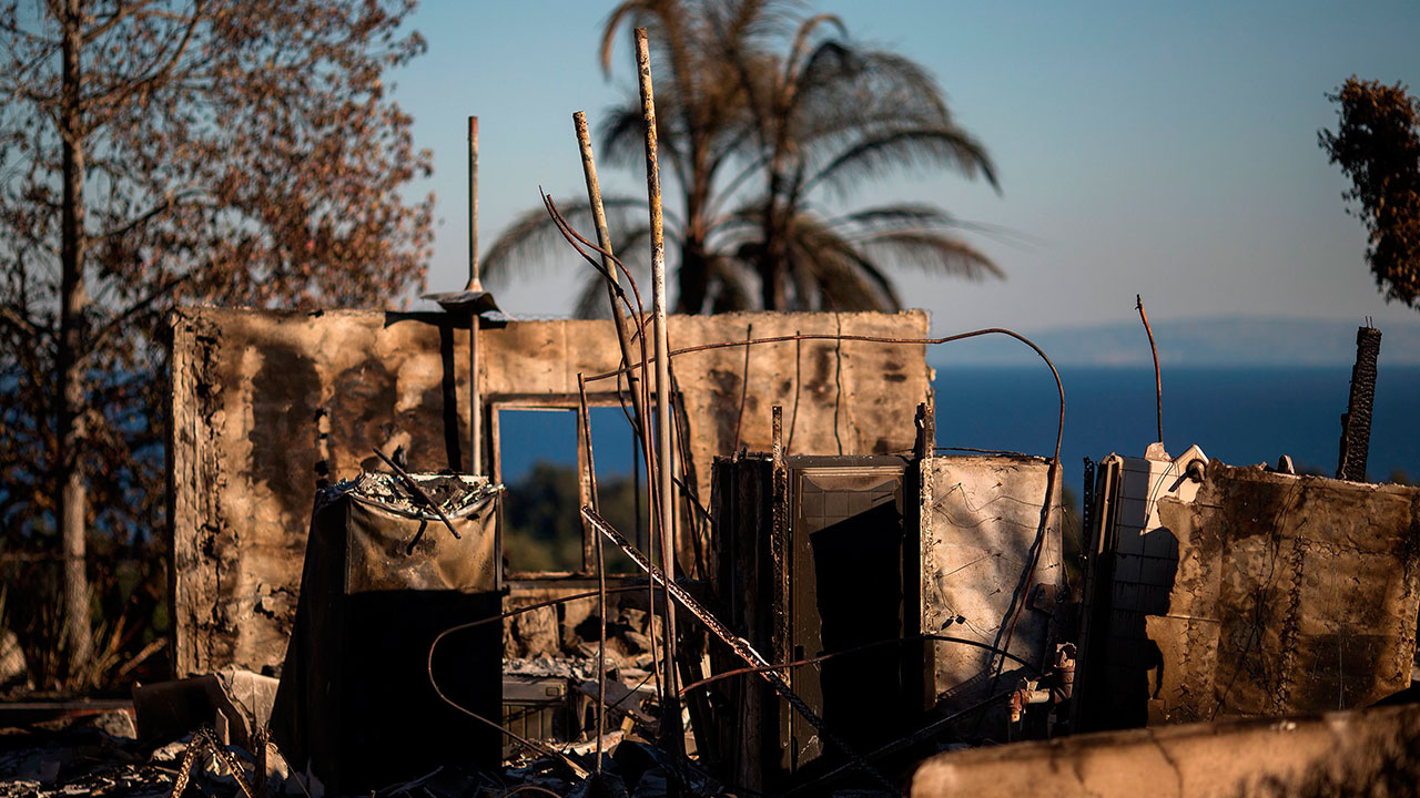 The ruins of an ocean view home are seen in the aftermath of the Woolsey Fire in Malibu, California on November 14, 2018.