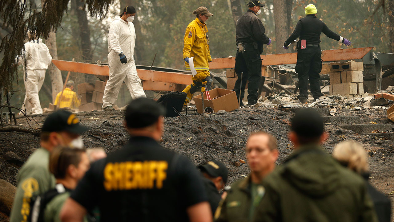 Investigators recover human remains at a home burned in the Camp Fire, Thursday, Nov. 15, 2018, in Magalia, Calif.