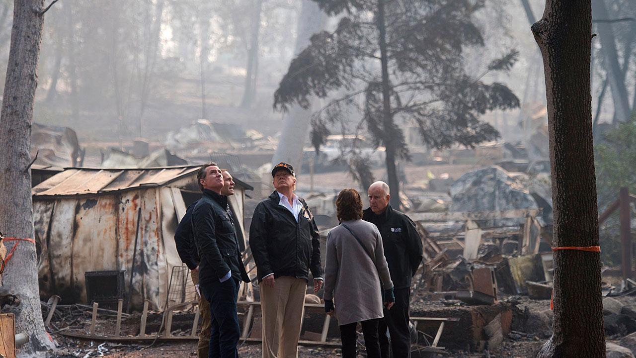 Gov.-elect Gavin Newson, FEMA Director Brock Long, President Donald Trump, Paradise mayor Jody Jones and Gov. Jerry Brown tour the Skyway Villa Mobile Home and RV Park on Nov. 17.