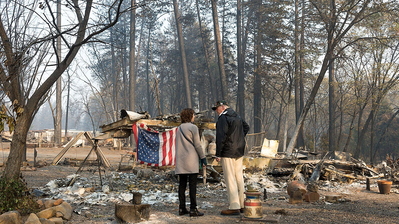 President Donald Trump surveys the damage with Paradise Mayor Jody Jones as they tour the Skyway Villa Mobile Home and RV Park during his visit of the Camp Fire in Paradise, Calif.