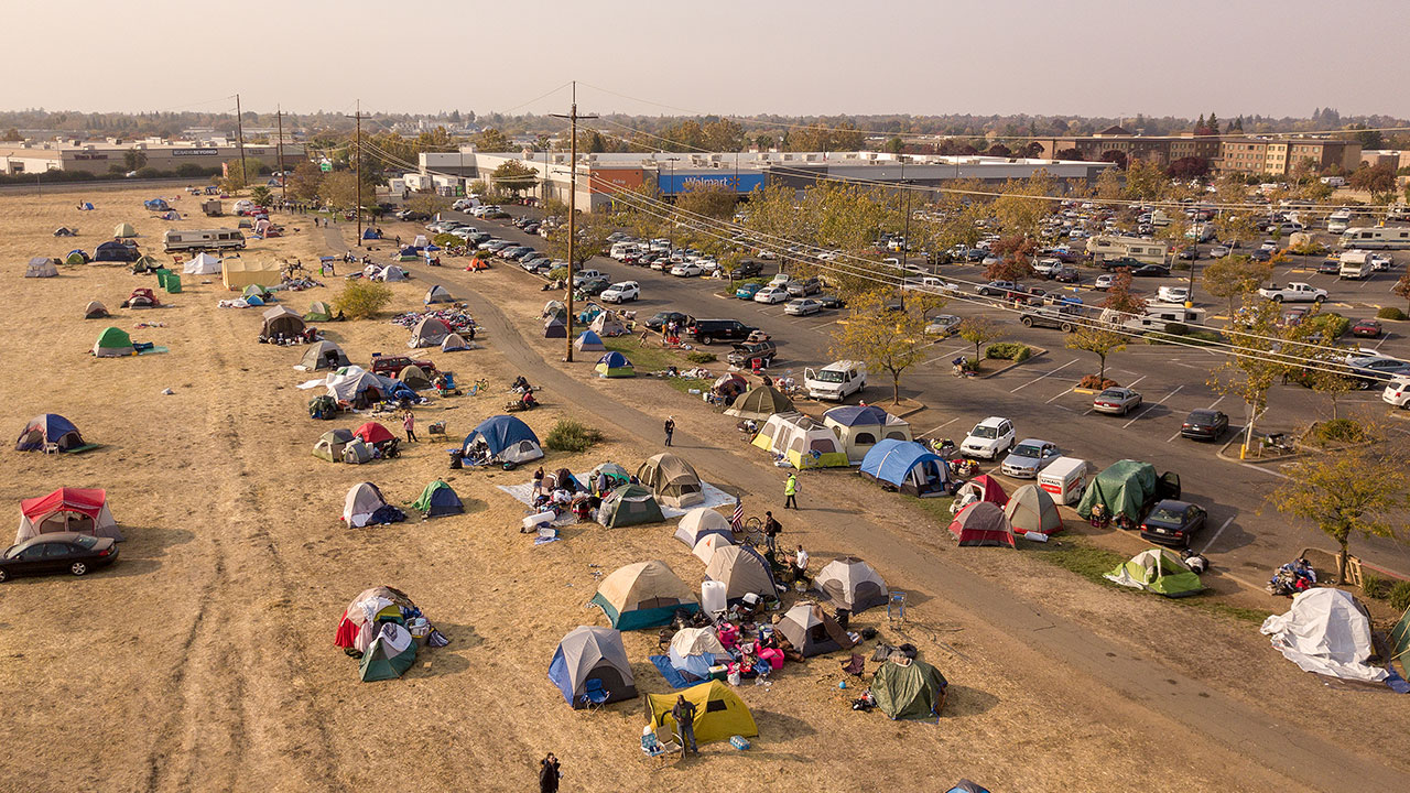 In this aerial photograph, an evacuee encampment is seen at a Walmart parking lot in Chico, California on November 19, 2018.