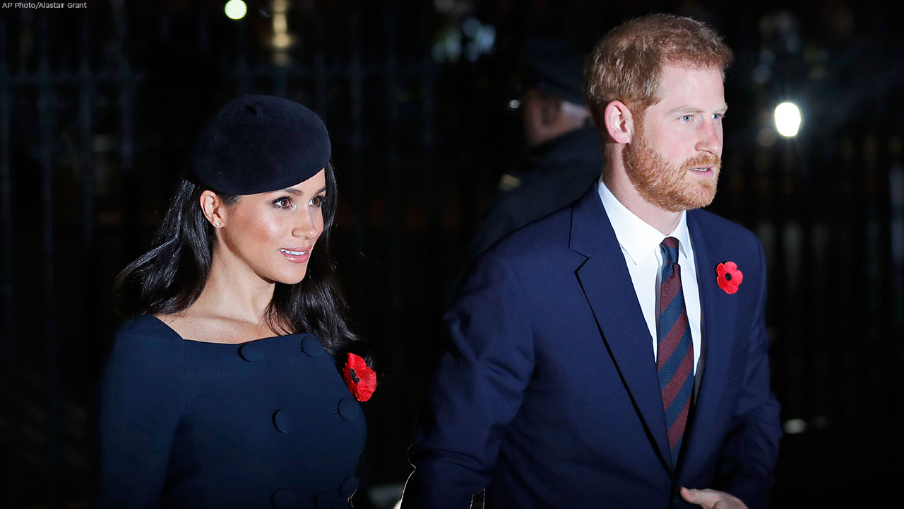 Meghan, Duchess of Sussex, left, and Prince Harry arrives at Westminster Abbey to attend the National Service to mark the Centenary of the Armistice in London, Nov. 11, 2018.