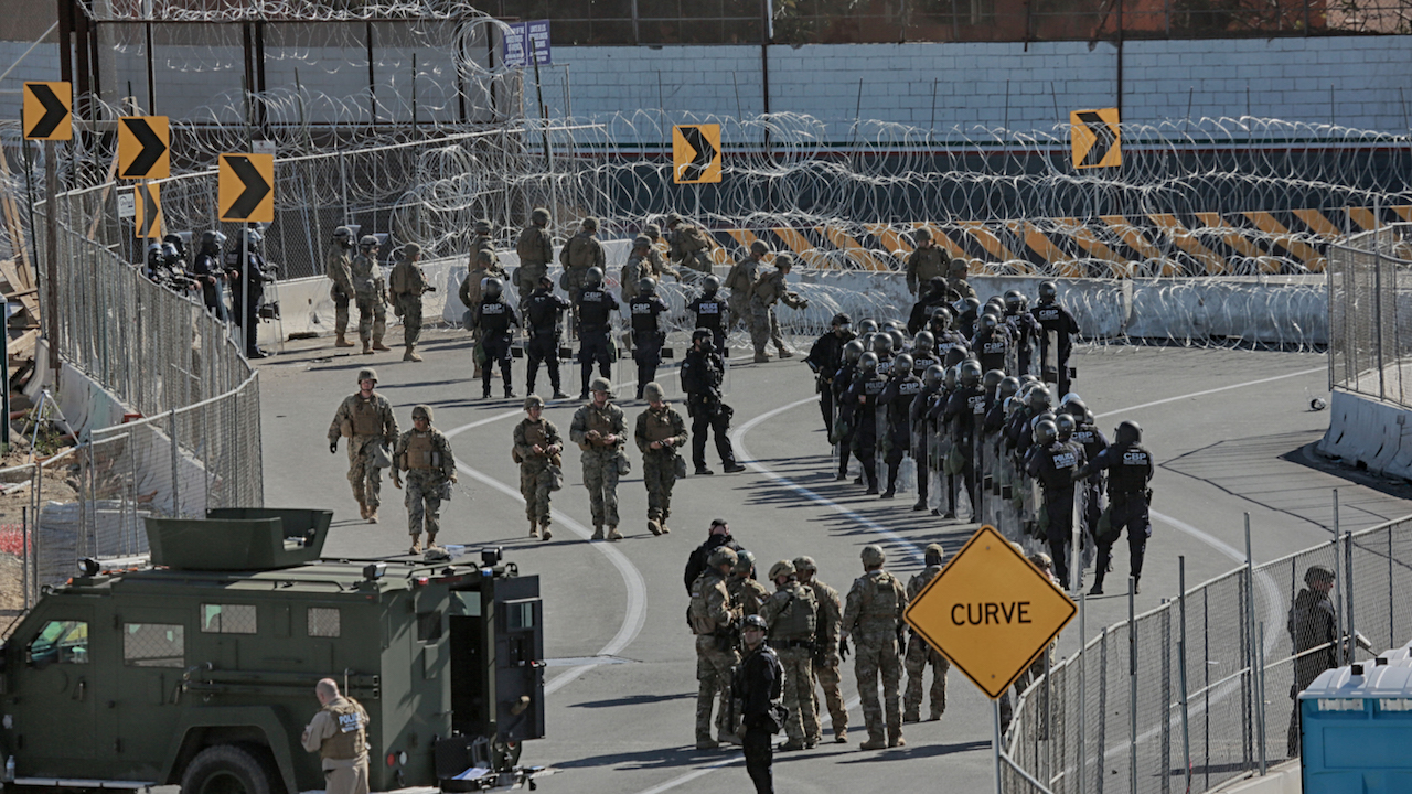 United States Military personnel and Border Patrol agents secure the United States-Mexico border on November 25, 2018, at the San Ysidro border crossing point south of San Diego.