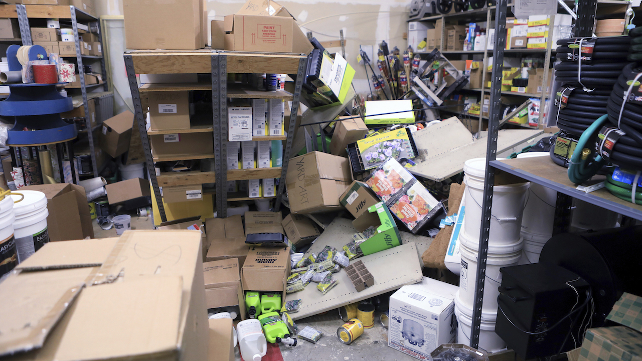 Items from two shelves that came unbolted from a wall are strewn across the floor of the stockroom of Anchorage True Value Hardware following an earthquake Friday morning.