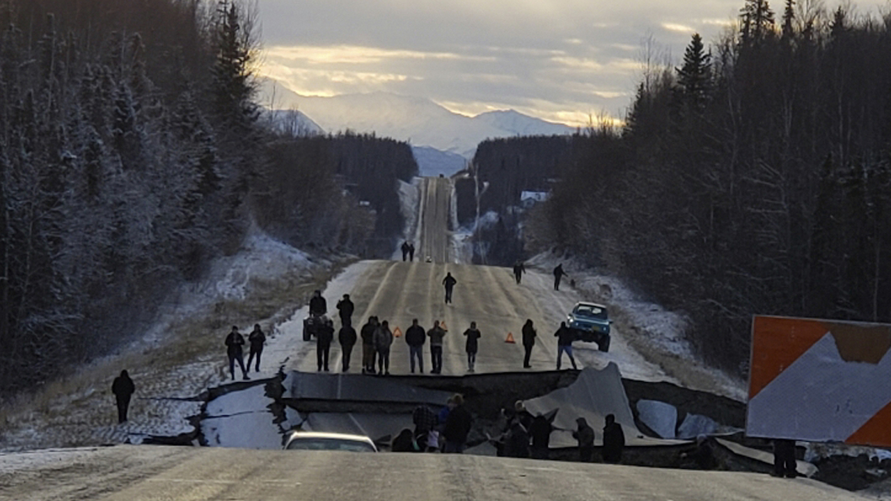 In this photo provided by Jonathan M. Lettow, people walk along Vine Road after an earthquake, Friday, Nov. 30, 2018, in Wasilla, Alaska.
