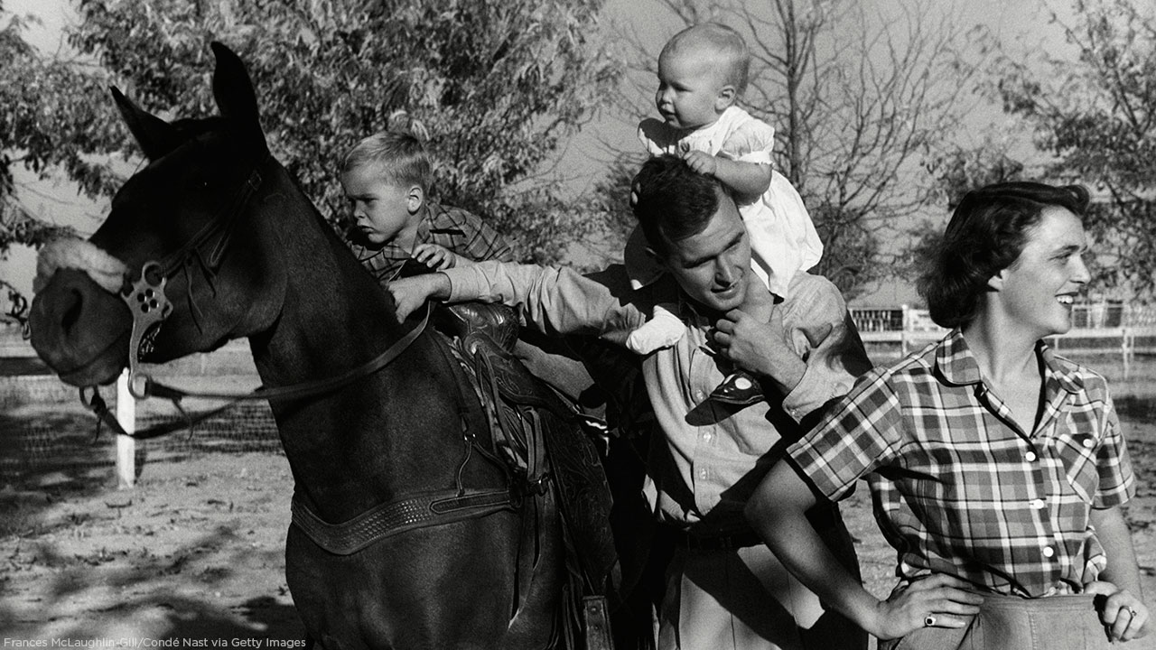 George H. W. Bush with his wife, Barbara, and their children Pauline and George W. on a horse in the yard of their Midlands, Texas, ranch.