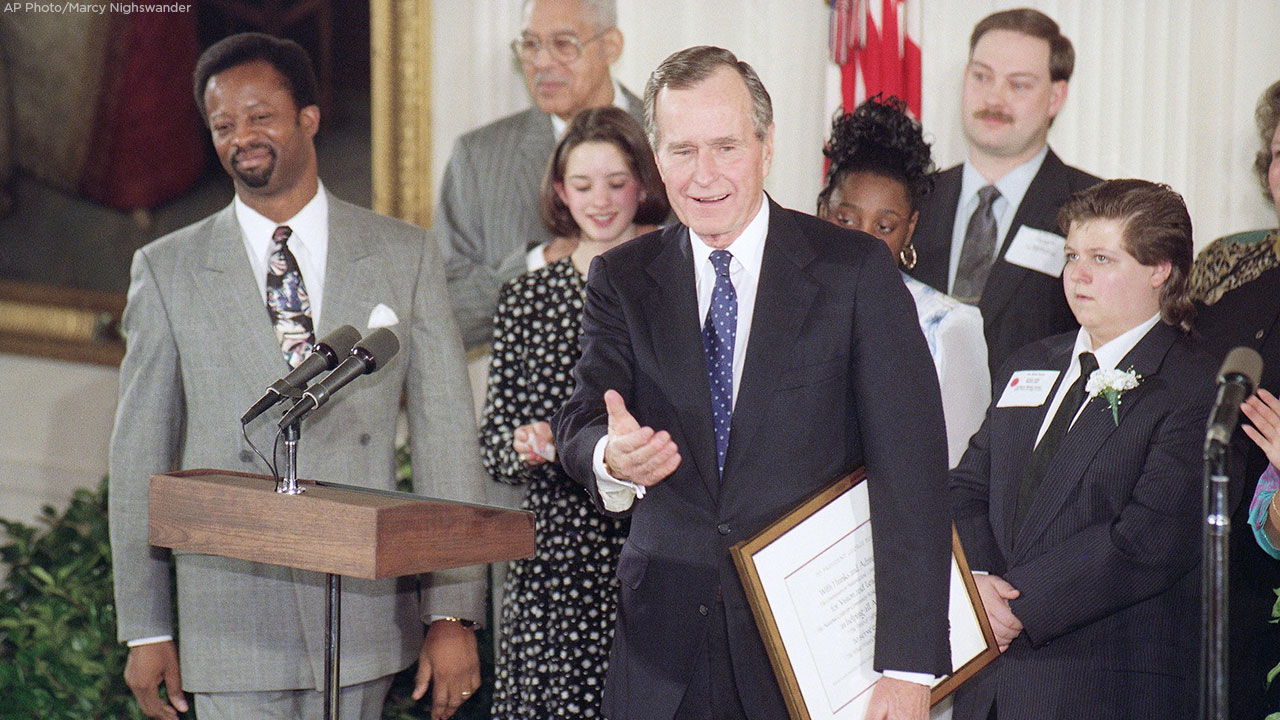Pres. George H. W. Bush, center, surrounded by Points of Light recipients, speaks at the White House during a ceremony honoring the recipients, Thursday, Jan. 14, 1993.