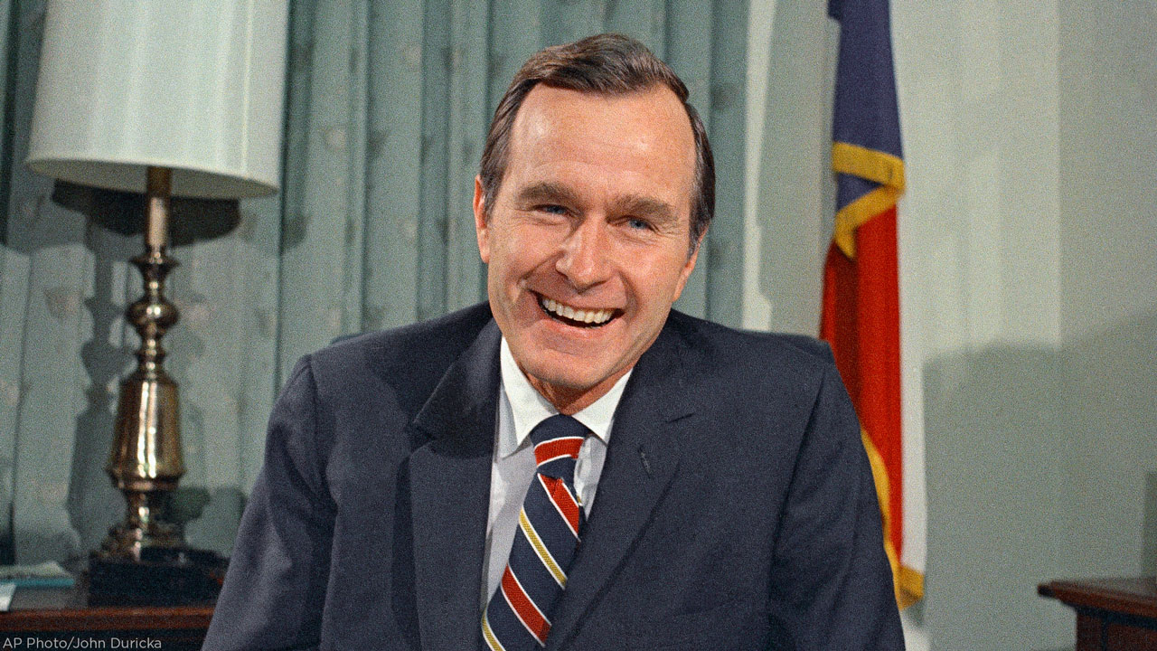 In this Dec. 18, 1970, file photo, newly appointed United Nations Ambassador George H. Bush smiles.