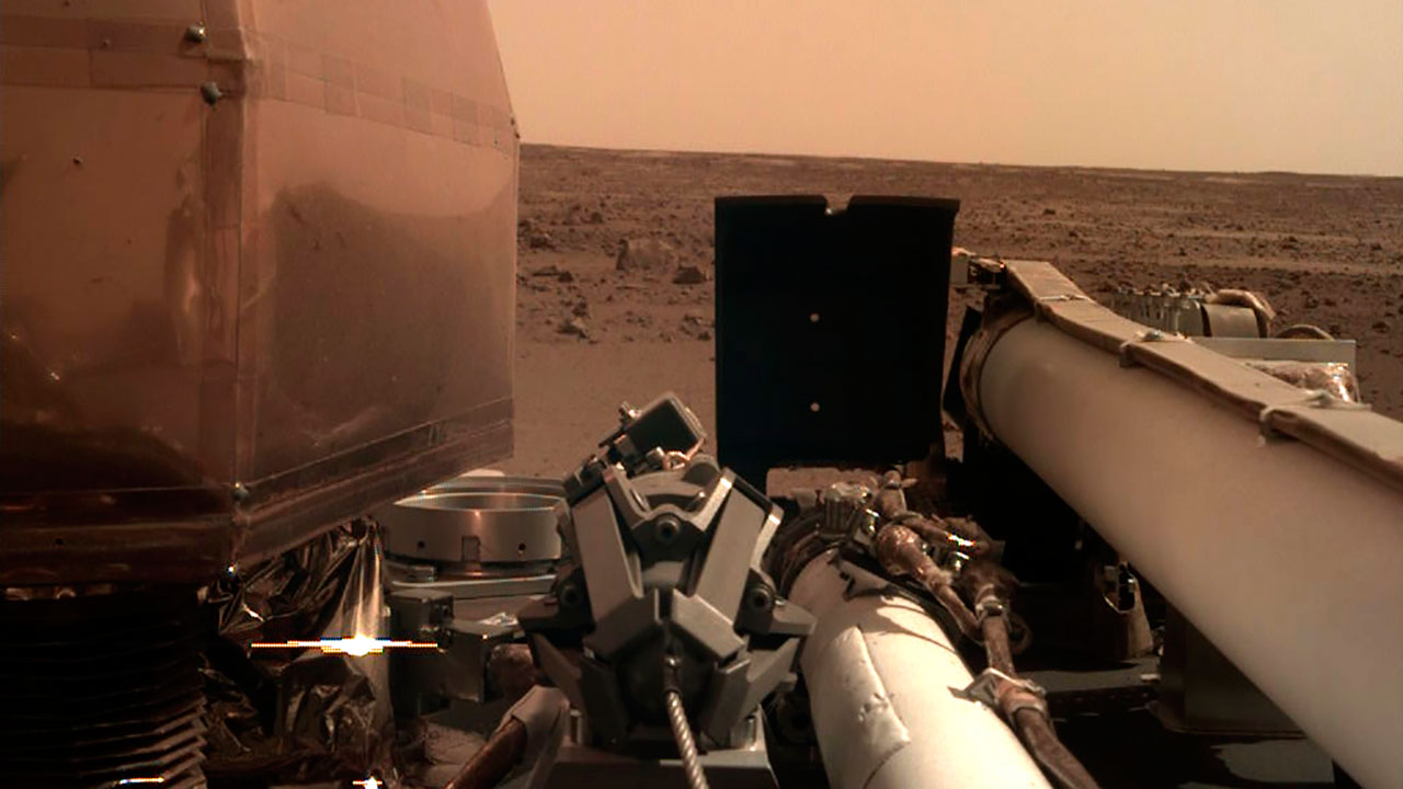 This photo provided by NASA shows an image on Mars that its spacecraft called InSight acquired after it landed on the planet on Monday, Nov. 26, 2018.