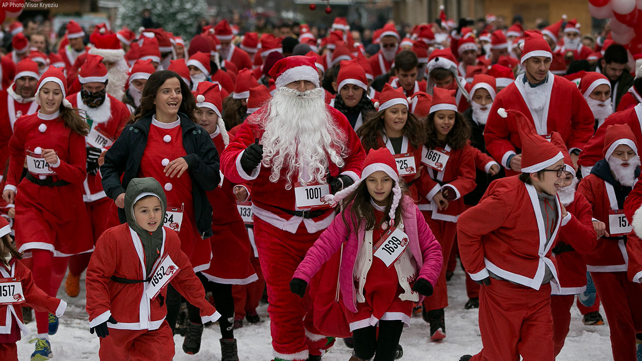 Runners wearing Santa Claus costumes participate in the 3rd Santa Claus run in Kosovo capital Pristina on Sunday, Dec. 16, 2018.