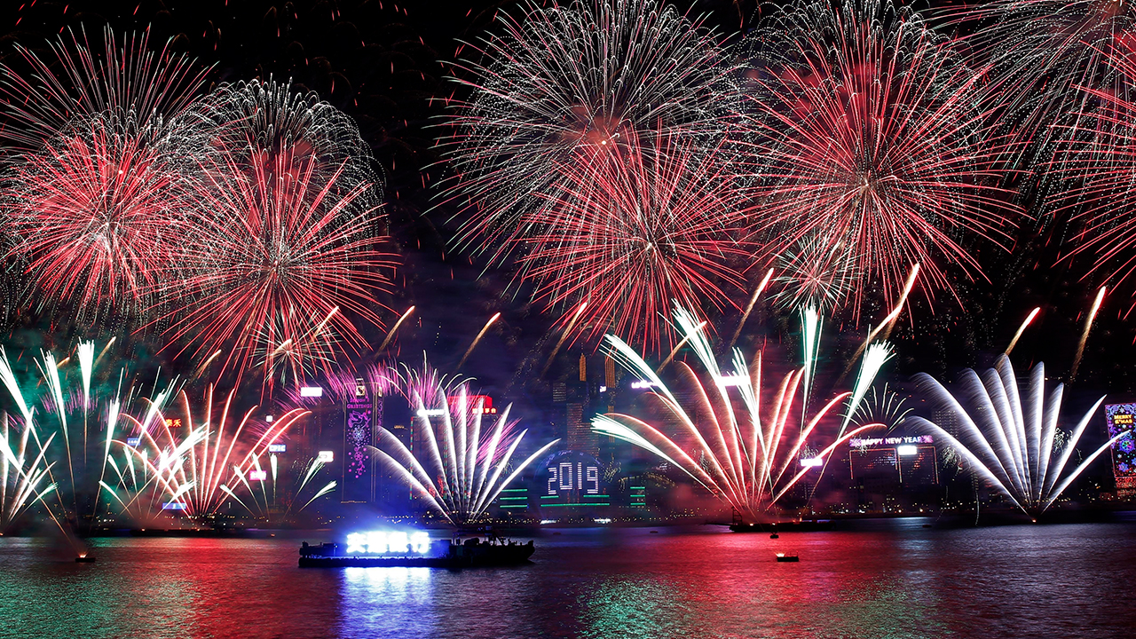 Fireworks explode over the Victoria Harbor during New Years Eve to celebrate the start of year 2019 in Hong Kong, Tuesday, Jan. 1, 2019.