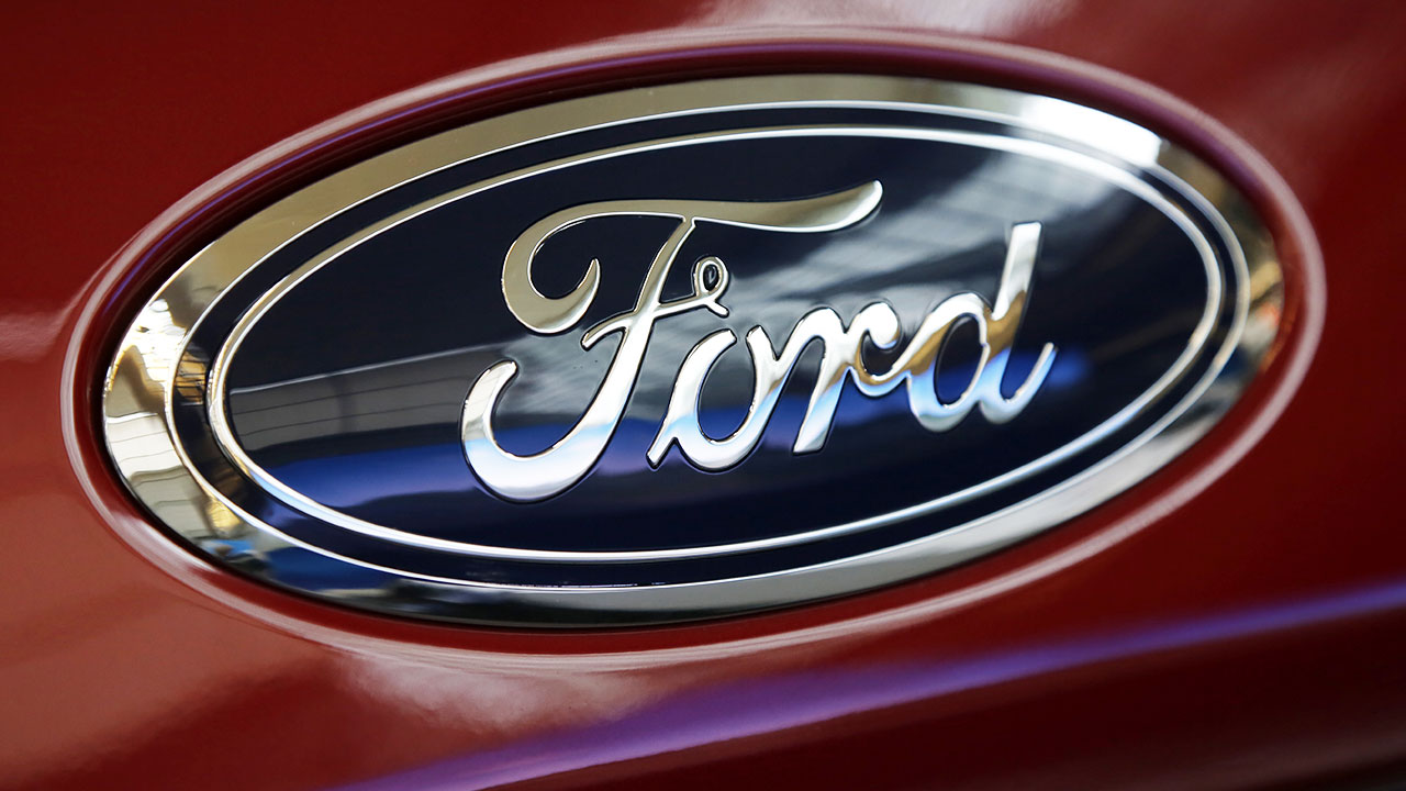 This Feb. 15, 2018, file photo shows a Ford logo on a vehicle at the Pittsburgh Auto Show in Pittsburgh.