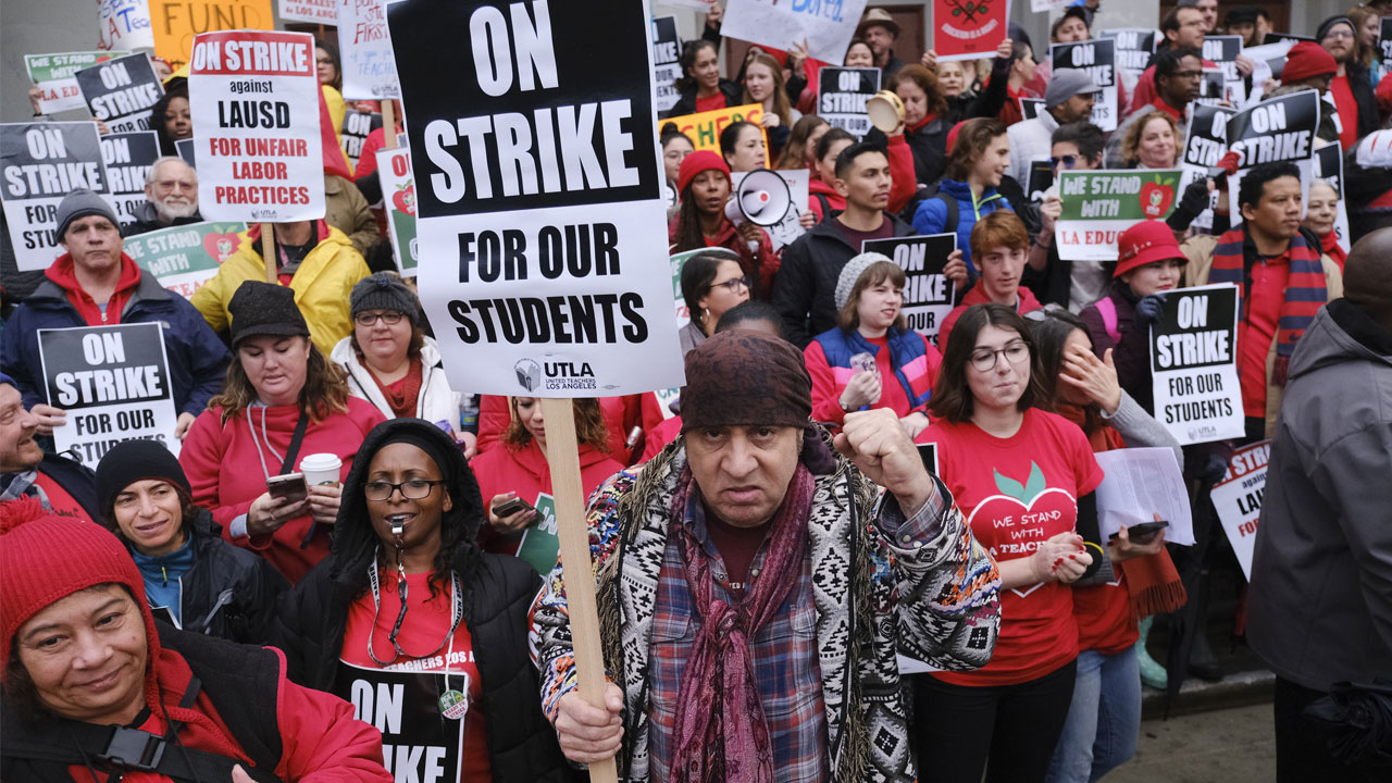 Actor, musician and activist, Steven Van Zandt, center, supports striking teachers on the picket in front of Hamilton High School in Los Angeles.