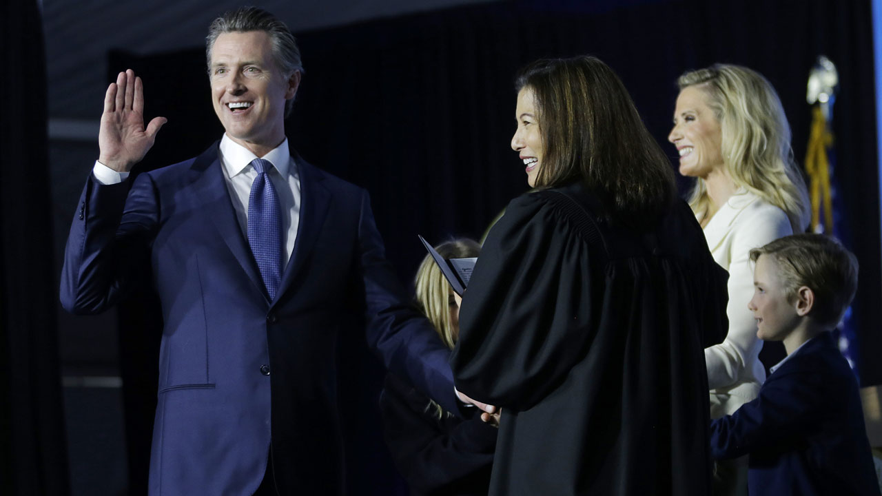 California Governor Gavin Newsom takes the oath of office from state Supreme Court Chief Justice Tani Gorre Cantil-Sakauye during his inauguration in Sacramento, Calif.