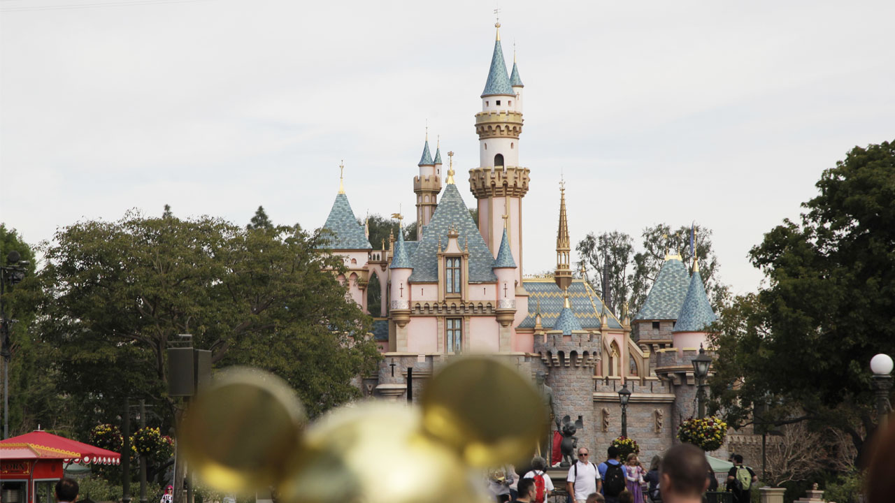 People walk toward the Sleeping Beautys Castle in the background at Disneyland, Thursday, Jan. 22, 2015, in Anaheim, California.