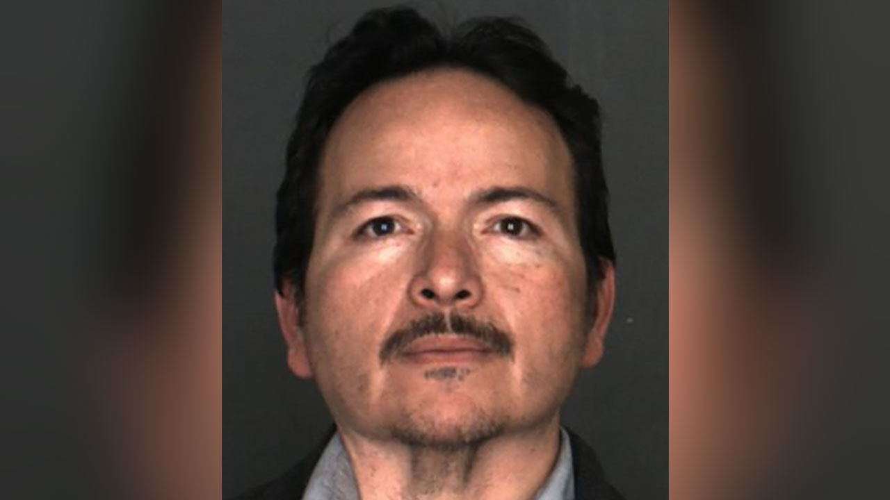 Jose Isabel Martinez is seen in a booking photo.