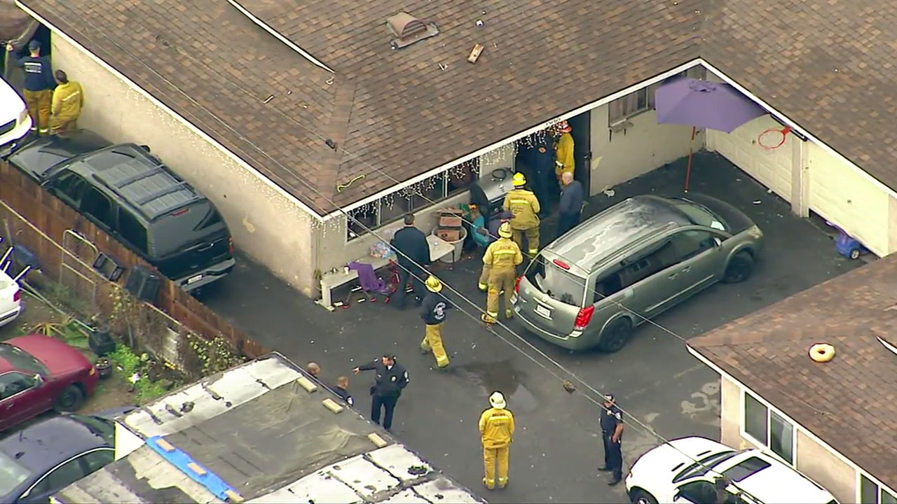 Authorities and emergency personnel surround a home in Bell Gardens after several people suffer carbon monoxide poisoning.