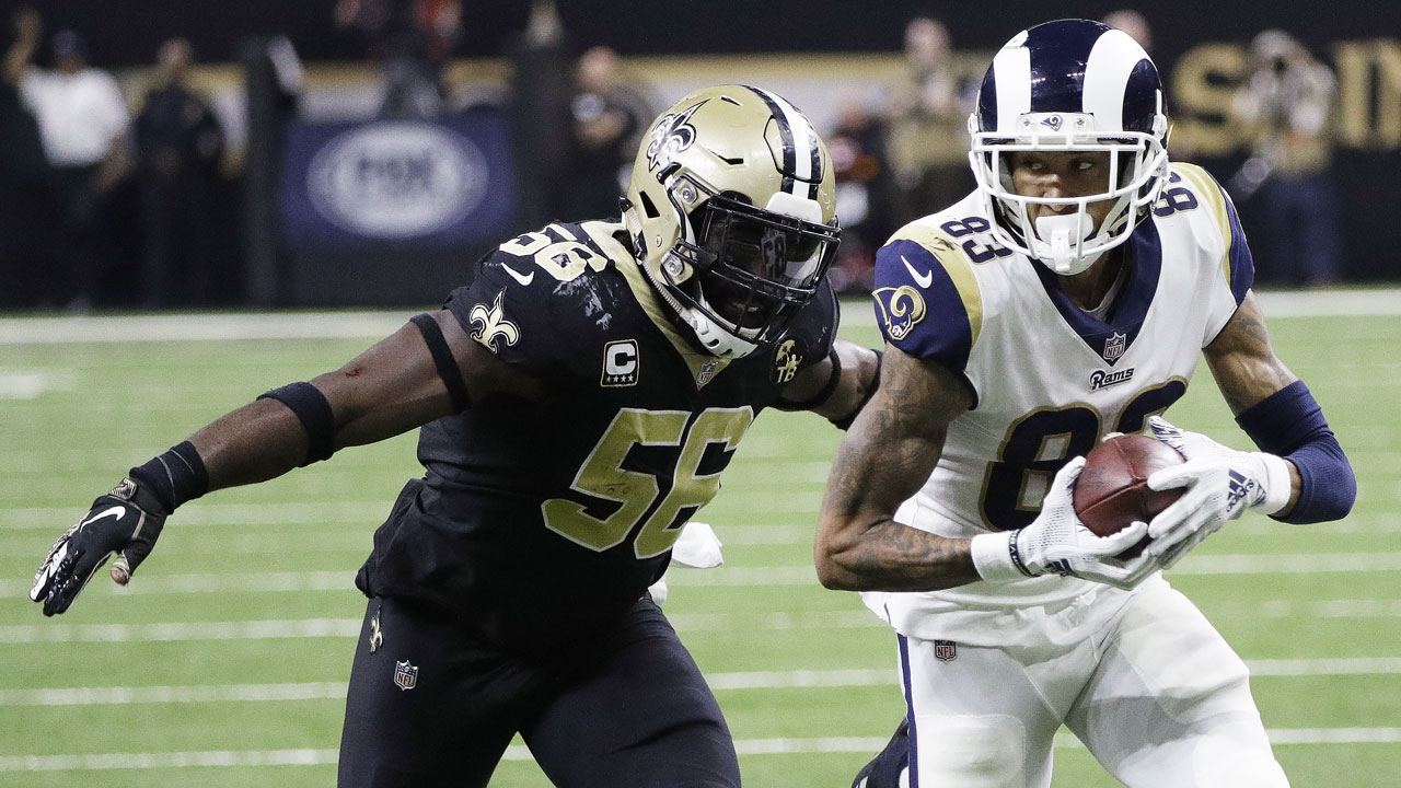Los Angeles Rams Josh Reynolds catches a pass in front of New Orleans Saints Demario Davis during the NFL football NFC championship game in New Orleans.