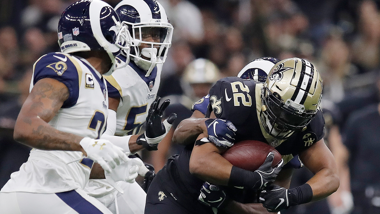 New Orleans Saints Mark Ingram is stopped during the second half of the NFL football NFC championship game against the Los Angeles Rams, Sunday, Jan. 20, 2019, in New Orleans.