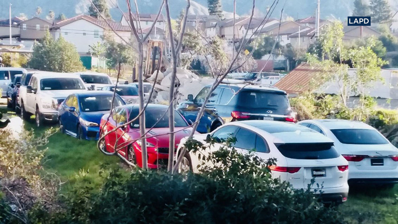 LAPD officers impounded 21 cars after tracking a LoJack signal to a Sylmar location.