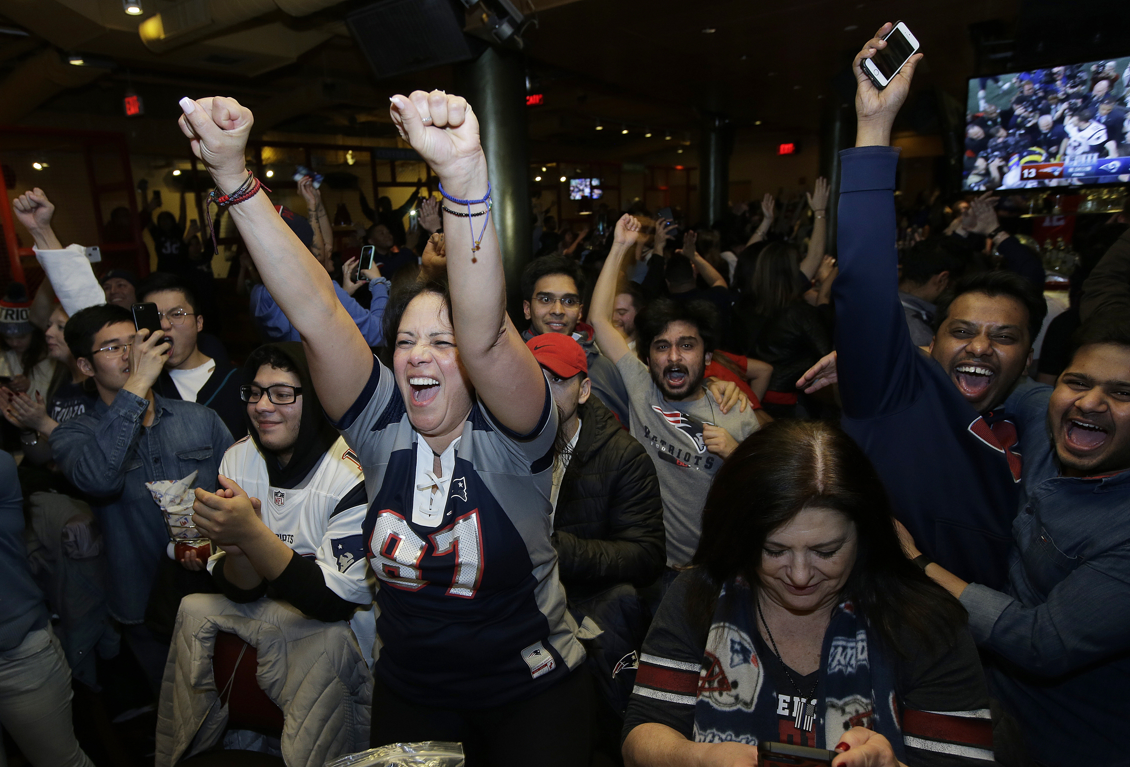 New England Patriots fans celebrate after the Patriots defeated the Los Angeles Rams in the NFL Super Bowl 53 football game in Atlanta at a bar in Boston on Sunday, Feb. 3, 2019.