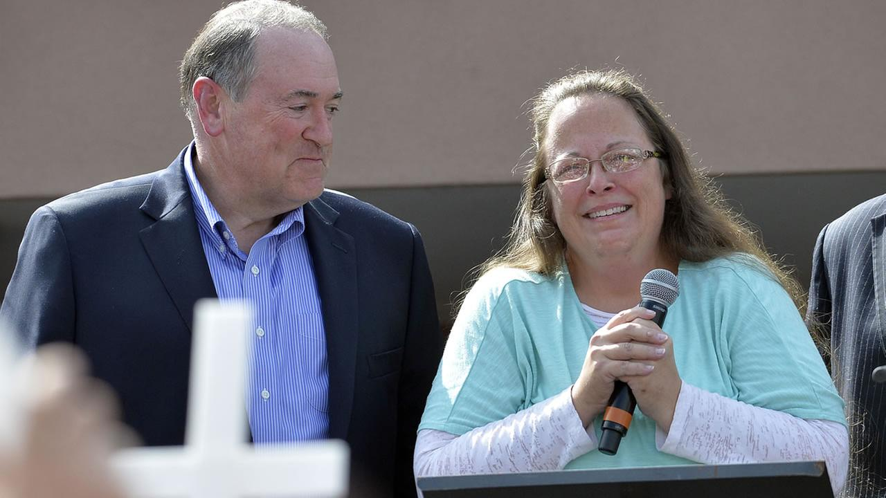 Rowan County Clerk Kim Davis, with Republican presidential candidate Mike Huckabee at her side speaks after being released from jail on Tuesday, Sept. 8, 2015, in Grayson, Ky.
