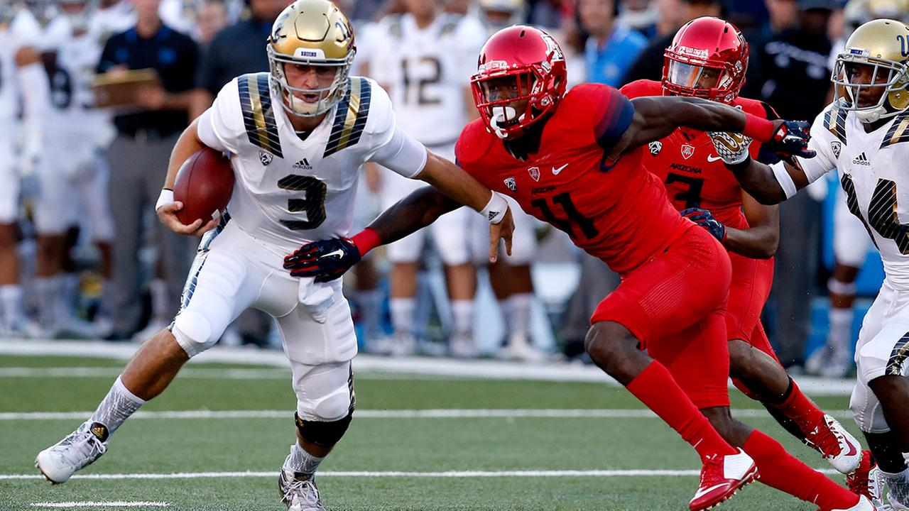 UCLA quarterback Josh Rosen (3) gets away from Arizona safety Will Parks during the first half of an NCAA college football game, Saturday, Sept. 26, 2015, in Tucson, Ariz.