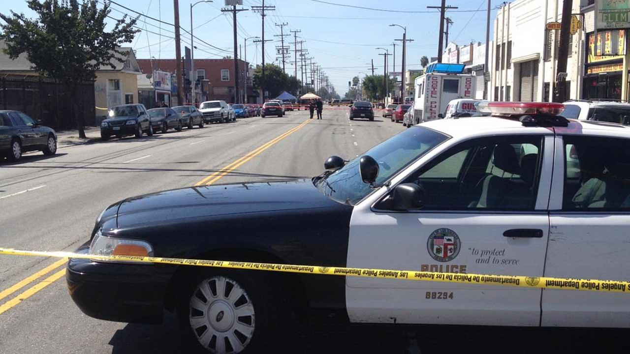 Los Angeles police investigate a fatal officer-involved shooting near E. 22nd and S. San Pedro streets in South Los Angeles on Sunday, Sept. 27, 2015.