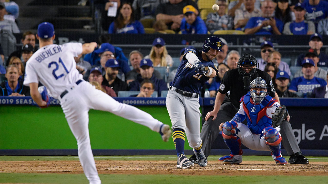 The Brewers Travis Shaw hits a triple off Dodgers pitcher Walker Buehler during Game 3 of the National League Championship Series at Dodger Stadium on Monday, Oct. 15, 2018.