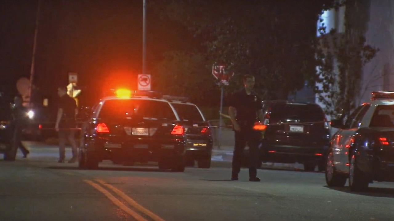 Los Angeles police investigate a fatal shooting near Saticoy Street and Bellaire Avenue in North Hollywood on Sunday, Oct. 4, 2015.