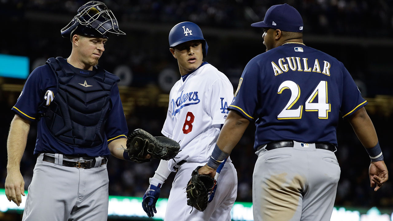 Brewers Jesus Aguilar and Dodgers Manny Machado have words during the 10th inning of Game 4 of the NLCS baseball game Tuesday, Oct. 16, 2018.