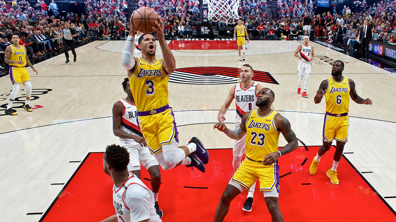 Lakers guard Josh Hart shoots over Portland Trail Blazers guard Evan Turner during the game in Portland, Ore., Thursday, Oct. 18, 2018.