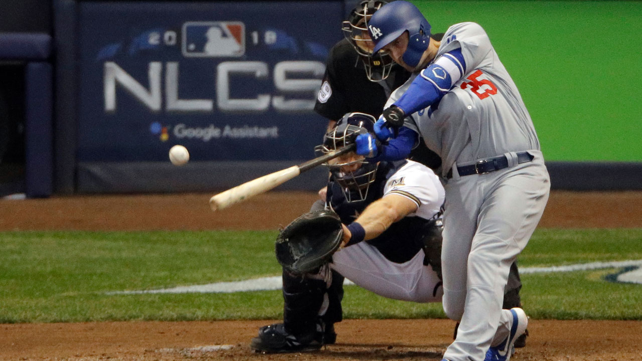 Los Angeles Dodgers David Freese hits an RBI double during Game 6 of the National League Championship Series baseball game against the Milwaukee Brewers in Milwaukee.