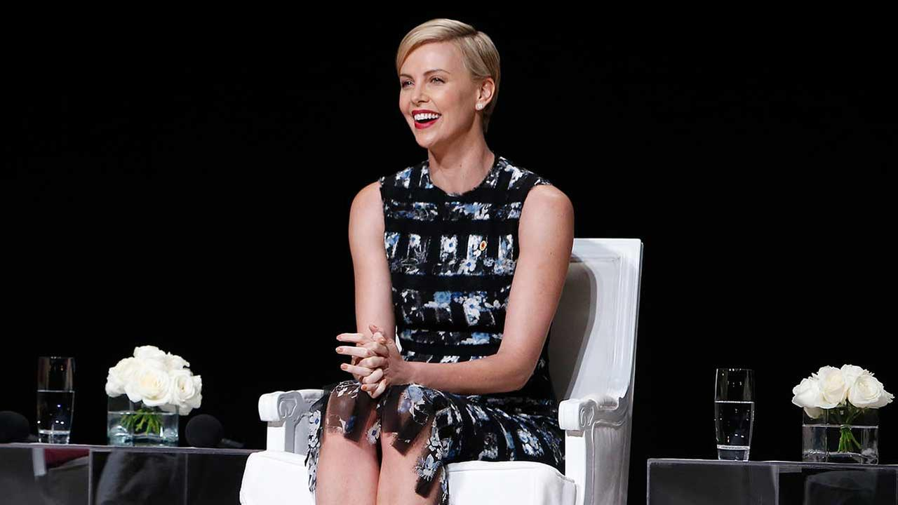 Actress Charlize Theron smiles during a panel discussion entitled The Power of an Educated Girl at the Apollo Theater, Tuesday, Sept. 29, 2015, in New York.