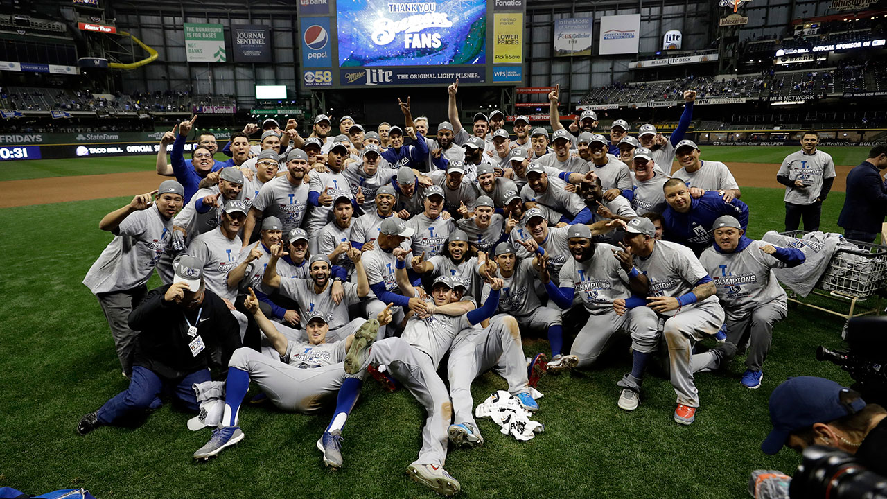 The Los Angeles Dodgers celebrate after winning Game 7 of the National League Championship Series against the Milwaukee Brewers.