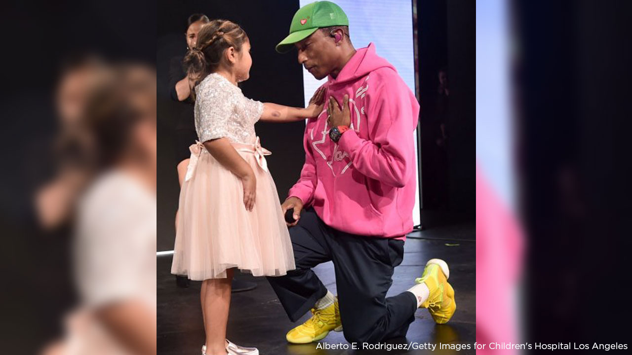 Eliana Georges onstage with Pharrell Williams at the 2018 Childrens Hospital Los Angeles From Paris With Love Gala on Saturday, Oct. 20, 2018.